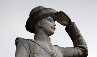 In this Feb. 23, 2019, file photo, a Confederate soldier monument stands at the University of Mississippi in Oxford, Miss. The monument will be moved from the prominent spot at the university to a Civil War cemetery in a secluded part of the Oxford campus. (AP Photo/Rogelio V. Solis, File)