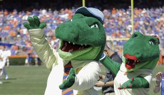 "In this Nov. 7, 2015, file photo, Albert and Alberta, the mascots for Florida, do the gator chomp before the first half of an NCAA college football game against Vanderbilt in Gainesville, Fla. The University of Florida is ending its ""gator bait"" cheer at football games and other sports events because of its racial connotations, the school's president announced Thursday, June 18, 2020, in a letter making several other similar changes on campus. (AP Photo/John Raoux, File)"