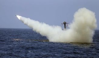 In this photo provided Thursday, June 18, 2020, by the Iranian Army, a warship launches a missile during a naval exercise. State media reported Thursday that Iran test fired cruise missiles in a naval exercise in the Gulf of Oman and northern Indian Ocean. The report by the official IRNA news agency said the missiles destroyed targets at a distance of 280 kilometers (170 miles). (Iranian Army via AP)