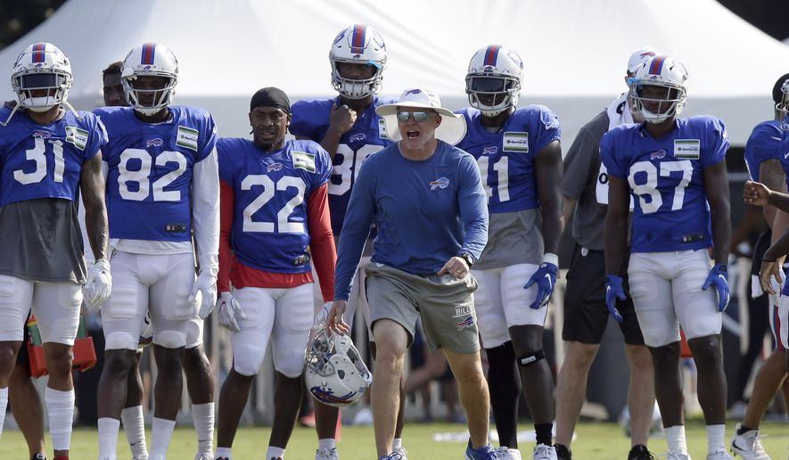 In this Aug 13, 2019, file photo, Buffalo Bills coach Sean McDermott yells during the team's NFL football training camp with the Carolina Panthers in Spartanburg, S.C. NFL general managers and coaches, and those who assist them, work within a highly competitive culture. Putting in extremely long hours is simply understood as part of the job. Unless, there's a pandemic. (AP Photo/Gerry Broome, File)   **FILE**