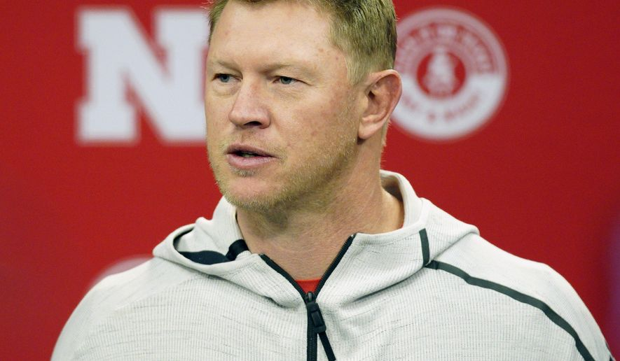 FILE - In this March 5, 2019, file photo, Nebraska NCAA college football coach Scott Frost answers a question during a news conference in Lincoln, Neb. Nebraska football coach Scott Frost and men's basketball coach Fred Hoiberg will donate a portion of their salaries to the athletic department's general operating fund to help offset revenue shortfalls because of the coronavirus pandemic. The athletic department said in a statement Thursday, June 18, 2020, the amount of the donations would be determined when the 2021 budget is closer to being finalized. Frost's salary is $5 million this year. Hoiberg is set to earn $3 million. (AP Photo/Nati Harnik, File)