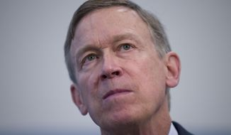 FILE - In this June 13 ,2019, file photo former Colorado Governor John Hickenlooper listens to a question during a media availability at the National Press Club in Washington. Hickenlooper was supposed to be Democrats' worry-free solution to the Colorado Senate race, but he's stumbled badly in the weeks leading up to the party's June 30 primary. (AP Photo/Alex Brandon, File)