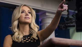 White House press secretary Kayleigh McEnany points to a question during a press briefing in the James Brady Press Briefing Room at the White House, Friday, June 19, 2020, in Washington. (AP Photo/Alex Brandon)