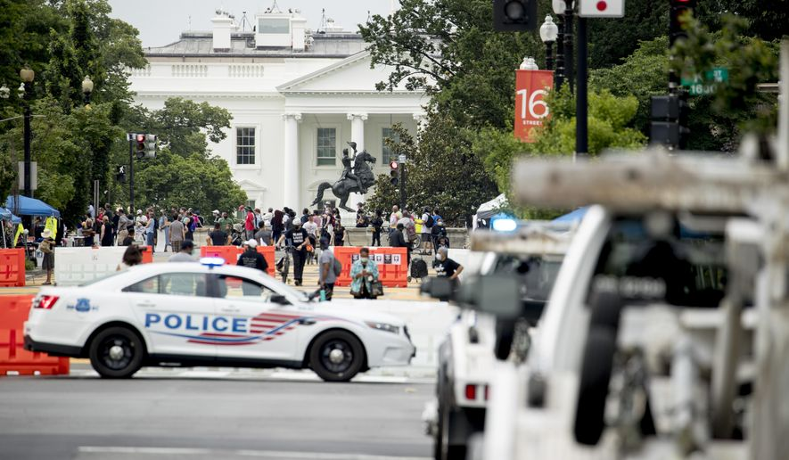 The White House is visible at 16th Street Northwest renamed Black Lives Matter Plaza, Friday, June 19, 2020, in Washington. (AP Photo/Andrew Harnik)