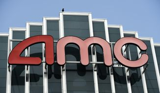 In this April 29, 2020, file photo, the AMC sign appears at AMC Burbank 16 movie theater complex in Burbank, Calif. (AP Photo/Chris Pizzello, File)