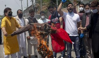 Bharatiya Janata Party (BJP) members shout slogans as they burn an effigy of Chinese President Xi Jinping during a protest against China in Srinagar, Indian controlled Kashmir, Friday, June 19, 2020. India's prime minister is meeting top opposition leaders Friday as the government tries to lower tensions with China after 20 Indian soldiers were killed in a clash in a Himalayan border region.  India and China accuse each other of instigating the fight in the Galwan Valley, part of the disputed Ladakh region along the Himalayan frontier. It was the deadliest conflict between the sides in 45 years. China has not said whether it suffered any casualties. (AP Photo/ Dar Yasin)