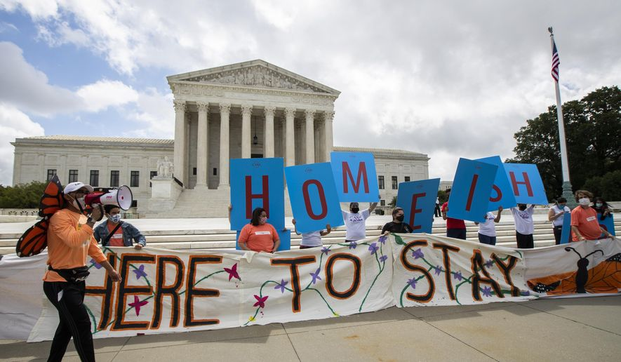 In this file photo, Deferred Action for Childhood Arrivals (DACA) recipient Roberto Martinez, left, celebrates with other DACA recipients in front of the Supreme Court on Thursday, June 18, 2020, in Washington after the Supreme Court rejected President Donald Trump's effort to end legal protections for 650,000 young immigrants, a stunning rebuke to the president in the midst of his reelection campaign. On July 17, 2020, a federal district judge in Maryland ruled that the Trump administration must essentially revive the DACA program as it existed before President Trump tried to phase it out in 2017 (AP Photo/Manuel Balce Ceneta)  **FILE**
