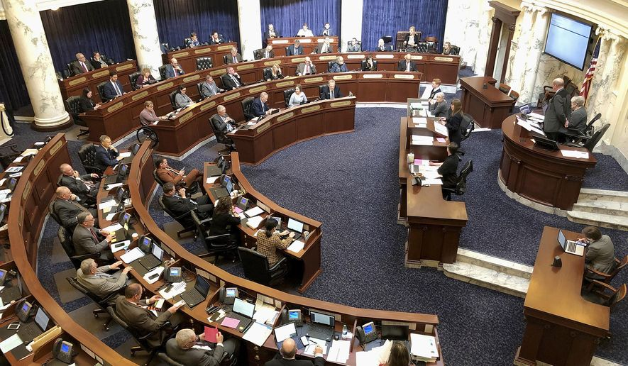 This Feb. 27, 2020, photo, shows the Idaho House of Representatives in the Idaho Statehouse in Boise, Idaho. The Trump administration is supporting Idaho's new law banning transgender women from competing in women's sports. It's the first law of its kind in the nation and the U.S. Department of Justice backed it in a court filing Friday, June 19, 2020. (AP Photo/Keith Ridler) **FILE**