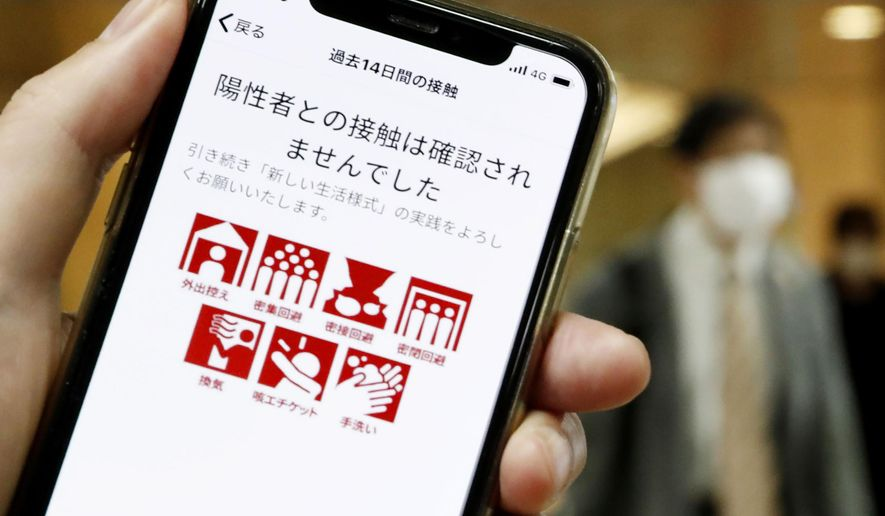 "The smartphone screen, seen in Tokyo, Japan, shows a trial version of the COVID-19 Contact Confirming Application, or COCOA, released Friday, June 19, 2020, by the Ministry of Health, Labor and Welfare. The notice says ""There was no close contact."" The coronavirus tracing app is designed to alert users if they come in contact with someone tested positive for the coronavirus.  Once installed, the app logs data via Bluetooth from phones that stay in close proximity for over 15 minutes.(Kyodo News via AP)"