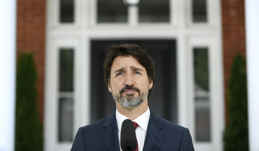 Canadian Prime Minister Justin Trudeau speaks during a news conference on the COVID-19 pandemic outside his residence at Rideau Cottage in Ottawa, Ontario, on Thursday, June 18, 2020. (Justin Tang/The Canadian Press via AP)