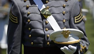 A Cadet listens during a commencement ceremony for the Class of 2020 on the parade field, at the United States Military Academy in West Point, N.Y., Saturday, June 13, 2020. (AP Photo/Alex Brandon)
