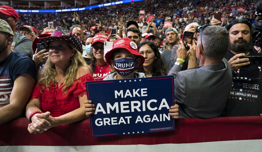 Supporters of President Donald Trump watch as he arrives on stage to speak to a campaign rally at the BOK Center, Saturday, June 20, 2020, in Tulsa, Okla. (AP Photo/Evan Vucci)
