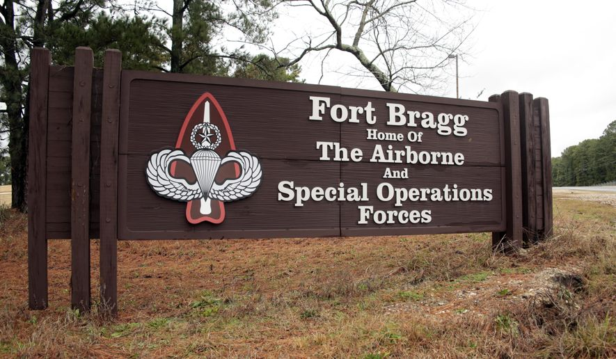 This Jan. 4, 2020, file photo shows a sign for at Fort Bragg, N.C.  The fight over removing the names of Confederate generals from U.S. Army bases, like Fort Bragg in Fayetteville, has become a national debate. (AP Photo/Chris Seward, File)