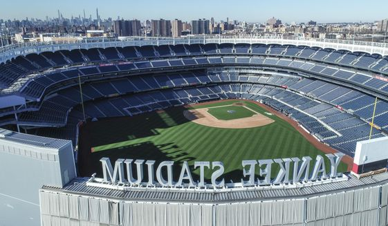 This March 26, 2020 file photo shows an empty Yankee Stadium on opening day due to COVID-19 coronavirus restrictions in the Bronx borough of New York. The Yankees and Mets would train in New York if Major League Baseball and its players try to start the coronavirus-delayed season. New York Gov. Andrew Cuomo made the announcement Saturday, June 20, 2020, and the teams confirmed the decisions. (John Woike/Samara Media via AP)  **FILE**