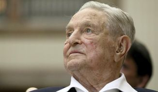 FILE - In this June 21, 2019, file photo, George Soros, Founder and Chairman of the Open Society Foundations, looks before the Joseph A. Schumpeter award ceremony in Vienna, Austria. Soros, the billionaire investor and philanthropist who has long been a target of conspiracy theories, is now being falsely accused of orchestrating and funding the protests over police killings of black people that have roiled the United States. (AP Photo/Ronald Zak, File)