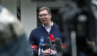 Serbia's President Aleksandar Vucic, addresses the media outside a polling station, in Belgrade, Serbia, Sunday, June 21, 2020. Serbia's ruling populists are set to tighten their hold on power in a Sunday parliamentary election held amid concerns over the spread of the coronavirus in the Balkan country and a partial boycott by the opposition. (AP Photo/Darko Vojinovic)