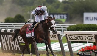 Tiz the Law (8), with jockey Manny Franco up, crosses the finish line to win the152nd running of the Belmont Stakes horse race, Saturday, June 20, 2020, in Elmont, N.Y. (AP Photo/Seth Wenig)  **FILE**