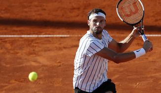 Bulgaria's Grigor Dimitrov returner the ball to Austria's Dominic Thiem during their match of the Adria Tour charity tournament in Belgrade, Serbia, Sunday, June 14, 2020. (AP Photo/Darko Vojinovic)