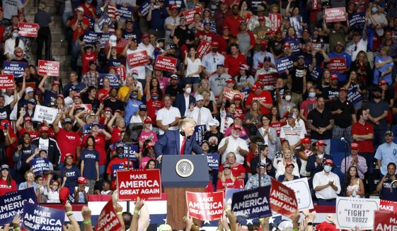 President Donald Trump, front center, speaks at BOK Center during his rally in Tulsa, Okla., Saturday, June 20, 2020. (Stephen Pingry/Tulsa World via AP)