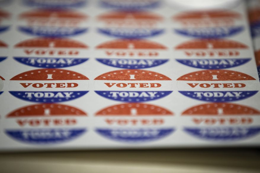 In this June 2, 2020, file photo, stickers for voters casting their ballots in the Pennsylvania primary sit on a table in Philadelphia. The civic ritual of casting a ballot has been disrupted by a global pandemic and dramatically animated by social unrest. (AP Photo/Matt Rourke, File)