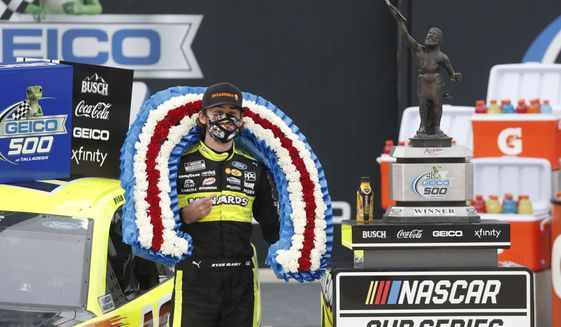 Ryan Blaney celebrates in Victory Lane after winning a NASCAR Cup Series auto race at Talladega Superspeedway in Talladega Ala., Monday, June 22, 2020. (AP Photo/John Bazemore)