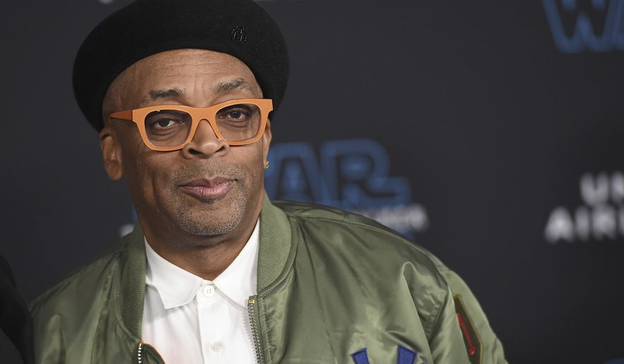 "FILE - In this Dec. 16, 2019 file photo, director Spike Lee arrives at the world premiere of ""Star Wars: The Rise of Skywalker"" in Los Angeles. The American Film Institute is offering free rentals of Do The Right Thing all week and will host a discussion with Lee of the 1989 film about racism and a neighborhood in turmoil. The AFI says its partnering with Universal Pictures to offer the film from Monday through Sunday on Amazon, Apple, Vudu and many other platforms. The Lee discussion will be held Thursday on AFI's YouTube channel. (Jordan Strauss/Invision/AP, File )"