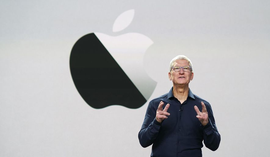 In this photo provided by Apple Inc., CEO Tim Cook delivers the keynote address during the 2020 Apple Worldwide Developers Conference Monday, June 22, 2020, in Cupertino, Calif. (Brooks Kraft/Apple Inc. via AP)