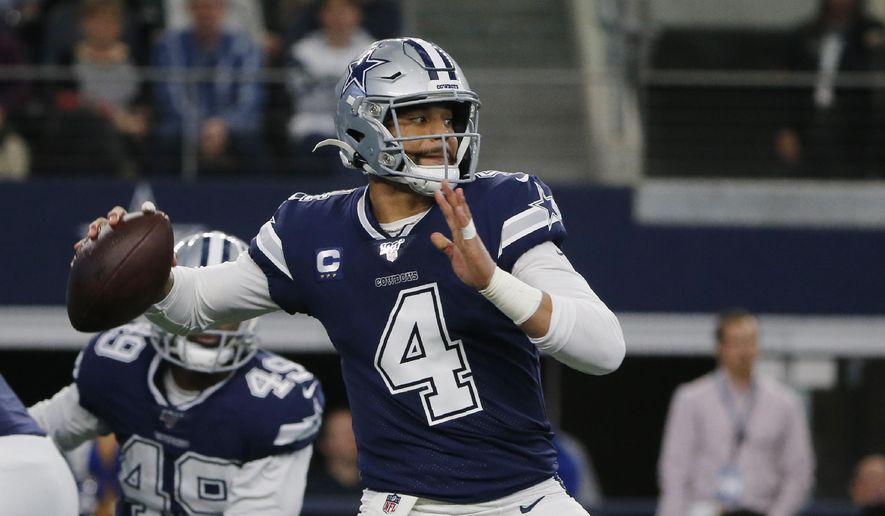 In this Dec. 15, 2019, file photo, Dallas Cowboys quarterback Dak Prescott (4) looks to throw in the first quarter of an NFL football game against the Los Angeles Rams in Arlington, Texas. The Cowboys have their star quarterback under contract for the 2020 season. Prescott has signed his $31.4 million tender under the franchise tag. That would be the richest one-year contract in franchise history. (AP Photo/Michael Ainsworth, File)  **FILE**