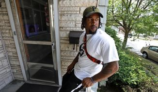 Daylan McLee sits on the porch of his home in Uniontown, Pa., Monday, June 22, 2020. On Sunday McLee helped pull Uniontown Police Officer Jay Hanley from his burning patrol car following a collision. (AP Photo/Gene J. Puskar)