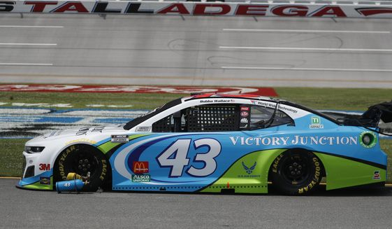 The car of Bubba Wallace (43) is prepped on pit row prior to the start of the NASCAR Cup Series auto race at the Talladega Superspeedway in Talladega Ala., Monday June 22, 2020. (AP Photo/John Bazemore)
