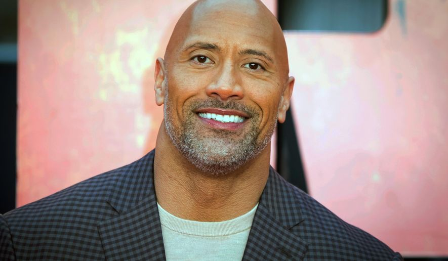 """Actor Dwayne Johnson poses for photographers at the premiere of the movie """"Rampage"""" in London, April 11, 2018. (Photo by Vianney Le Caer/Invision/AP) ** FILE **"""