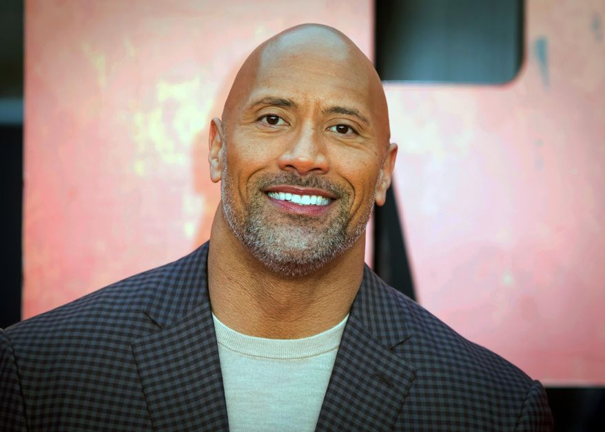 "Actor Dwayne Johnson poses for photographers at the premiere of the movie ""Rampage"" in London, April 11, 2018. (Photo by Vianney Le Caer/Invision/AP) ** FILE **"