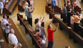 Worshippers practice social distancing using every other pew in The Church at Liberty Square resuming Sunday services in Cartersville, Ga., Sunday, June 7, 2020, for the first time since a major outbreak of the coronavirus disease at the chuch. The outbreak of COVID 19 sickened scores of worshippers and killed several. (Curtis Compton/Atlanta Journal-Constitution via AP)