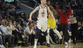 Washington Wizards forward Davis Bertans (42) reacts after shooting a 3-point basket against the Golden State Warriors during the second half of an NBA basketball game in San Francisco, Sunday, March 1, 2020. (AP Photo/Jeff Chiu)