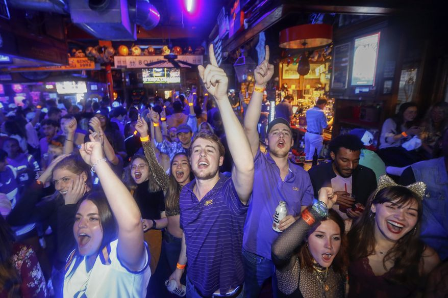 Hundreds of cases have been tied to student parties at Ole Miss in Oxford, Mississippi, and at Louisiana State University in Baton Rouge, where nearly three dozen players on the school's football team were quarantined. (Associated Press file photo)