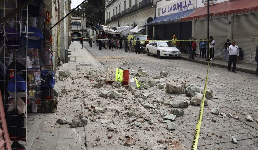 Security tape alert people of a building damaged by an earthquake in Oaxaca, Mexico, Tuesday, June 23, 2020.  The earthquake was centered near the resort of Huatulco, in the southern state of Oaxaca. (AP Photo/Luis Alberto Cruz Hernandez)