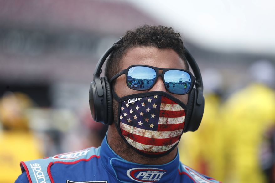 Driver Bubba Wallace prior to the start of the NASCAR Cup Series at the Talladega Superspeedway in Talladega, Ala., Monday, June 22, 2020. (AP Photo/John Bazemore) ** FILE **