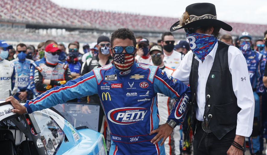 Team owner Richard Petty, right, stands with driver Bubba Wallace prior to the start of the NASCAR Cup Series at the Talladega Superspeedway in Talladega, Ala., Monday, June 22, 2020. (AP Photo/John Bazemore)