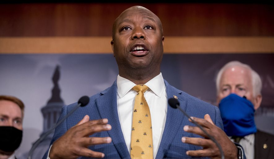 In this June 17, 2020, photo, Sen. Tim Scott, R-S.C., accompanied by Republican senators, speaks at a news conference to announce a Republican police reform bill on Capitol Hill in Washington. Initially reluctant to speak on race, Scott is now among the Republican Party's most prominent voices teaching his colleagues what it's like to be a Black man in America. (AP Photo/Andrew Harnik) **FILE**