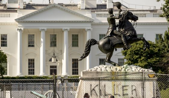 """The White House is visible behind a statue of President Andrew Jackson in Lafayette Park, Tuesday, June 23, 2020, in Washington, with the word """"Killer"""" spray painted on its base. Protesters tried to topple the statue Monday night. On Saturday, June 27, it was announced that four individuals who had tried to topple the statue were identified, one of whom has already had his initial appearance in court.  (AP Photo/Andrew Harnik)  **FILE**"""