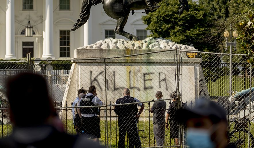 "The White House is visible behind a statue of President Andrew Jackson in Lafayette Park, Tuesday, June 23, 2020, in Washington, with the word ""Killer"" spray painted on its base. Protesters tried to topple the statue Monday night. President Tump had tweeted late Monday that those who tried to topple the statue of President Andrew Jackson in Lafayette Park across the street from the White House faced 10 years in prison under the Veteran's Memorial Preservation Act.  (AP Photo/Andrew Harnik)"