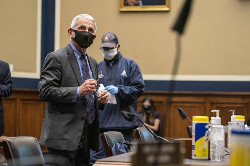 Director of the National Institute of Allergy and Infectious Diseases Dr. Anthony Fauci arrives to testify before a House Committee on Energy and Commerce on the Trump administration's response to the COVID-19 pandemic on Capitol Hill in Washington on Tuesday, June 23, 2020. (Sarah Silbiger/Pool via AP)