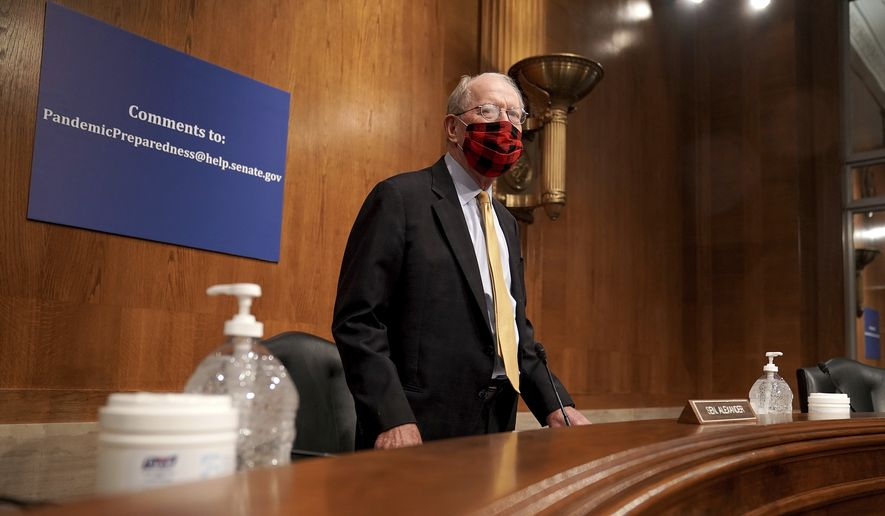 Committee Chairman Sen. Lamar Alexander, R-Tenn., arrives for a Senate Health, Education, Labor and Pensions Committee hearing, Tuesday, June 23, 2020, on Capitol Hill in Washington, to discuss the lessons learned during the coronavirus. (Greg Nash/Pool via AP)