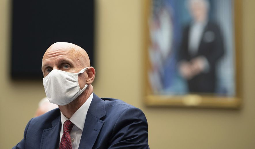 Food and Drug Administration Commissioner Dr. Stephen Hahn listens during a House Committee on Energy and Commerce on the Trump administration's response to the COVID-19 pandemic on Capitol Hill in Washington on Tuesday, June 23, 2020. (Kevin Dietsch/Pool via AP)