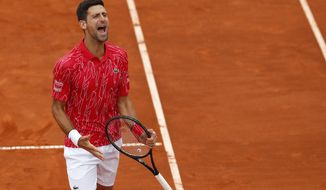 In this Friday, June 12, 2020. photo, Serbia's Novak Djokovic reacts during a tennis doubles match with Jelena Jankovic against Serbia's Nenad Zimonjic and Olga Danilovic at charity tournament Adria Tour, in Belgrade, Serbia. Novak Djokovic has tested positive for the coronavirus after taking part in a tennis exhibition series he organized in Serbia and Croatia. The top-ranked Serb is the fourth player to test positive for the virus after first playing in Belgrade and then again last weekend in Zadar, Croatia. His wife also tested positive. (AP Photo/Darko Vojinovic)  **FILE**
