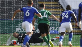 Leicester's goalkeeper Kasper Schmeichel saves a penalty during the English Premier League soccer match between Leicester City and Brighton & Hove Albion at the King Power Stadium, in Leicester, England, Tuesday, June 23, 2020. (Darren Staples/Pool via AP)