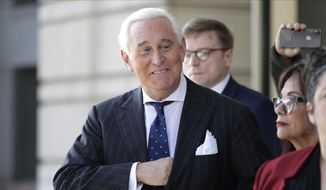 In this Nov. 15, 2019, file photo, Roger Stone exits the federal court in Washington. (AP Photo/Julio Cortez, File)