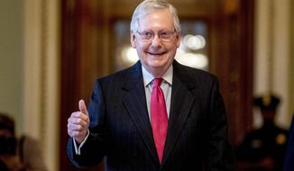 In this March 25, 2020, file photo, Senate Majority Leader Mitch McConnell, R-Ky. gives a thumbs-up as he leaves the Senate chamber on Capitol Hill in Washington. (AP Photo/Andrew Harnik)
