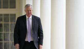 In this June 16, 2020, file photo, White House chief of staff Mark Meadows arrives for an event on police reform, in the Rose Garden of the White House in Washington. Voters in western North Carolina are choosing the Republican nominee for a congressional seat held by Meadows before he became Trump's chief of staff.Lynda Bennett and Madison Cawthorn were on Tuesday's ballot in the 11th Congressional District runoff. They were the top two vote-getters in a 12-candidate primary in March. (AP Photo/Evan Vucci, File)