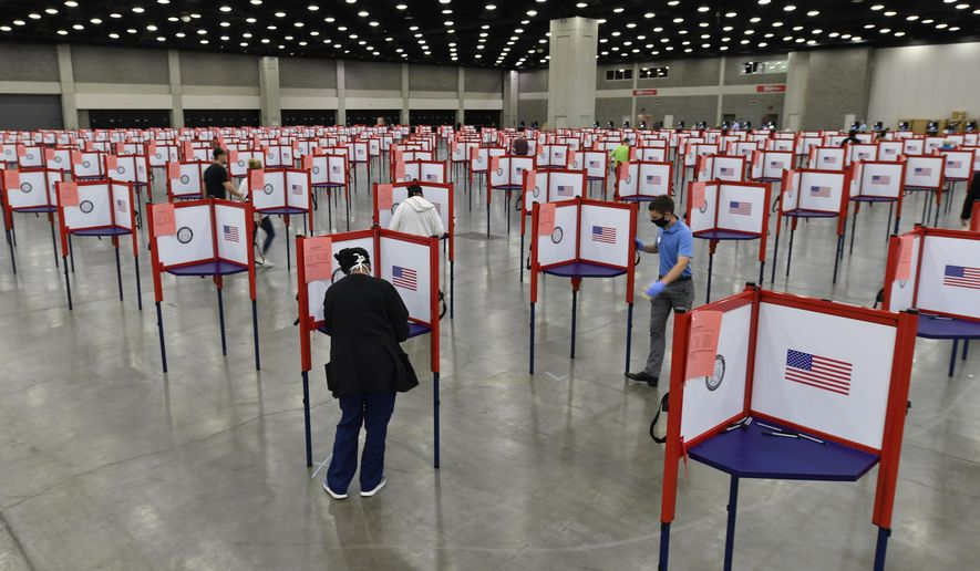Voting stations are set up in the South Wing of the Kentucky Exposition Center for voters to cast their ballot in the Kentucky primary in Louisville, Ky., Tuesday, June 23, 2020. In an attempt to prevent the spread of the coronavirus, neighborhood precincts were closed and voters that didn't cast mail in ballots were directed to one central polling location. (AP Photo/Timothy D. Easley)